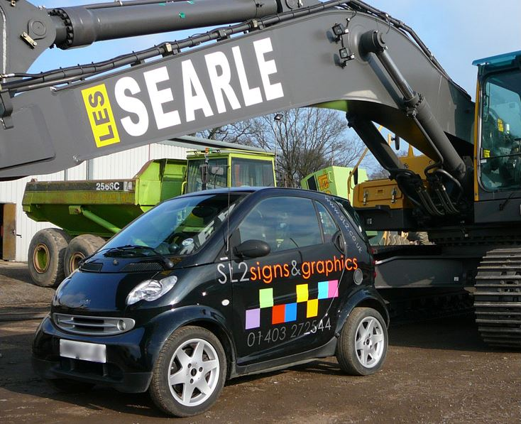 Black SL2 car with Searle consruction vehicle