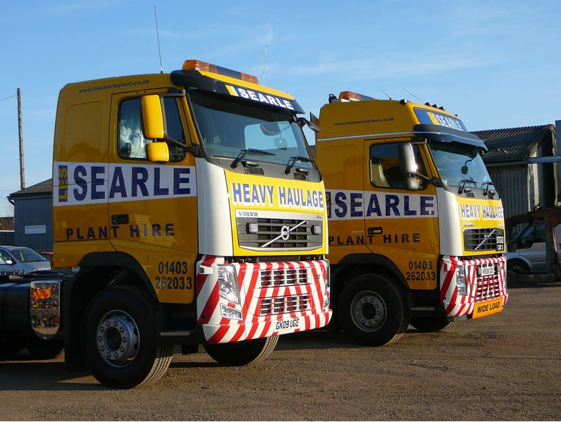Two Heavy Haulage trucks with vehicle graphics