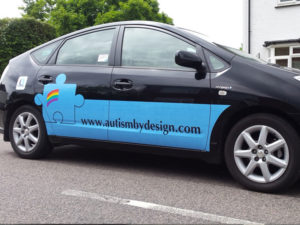 Autism by design vehicle graphic